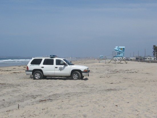 Except for RVs to the north, beach is almost empty.