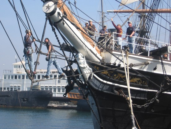 People tangled in picturesque ship's rigging.