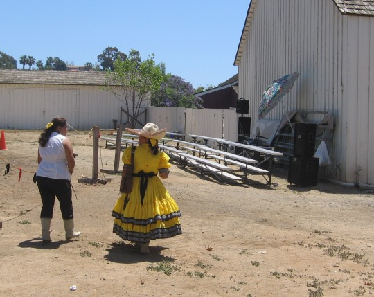 Bright dress worn by lady walking behind Seeley Stable.