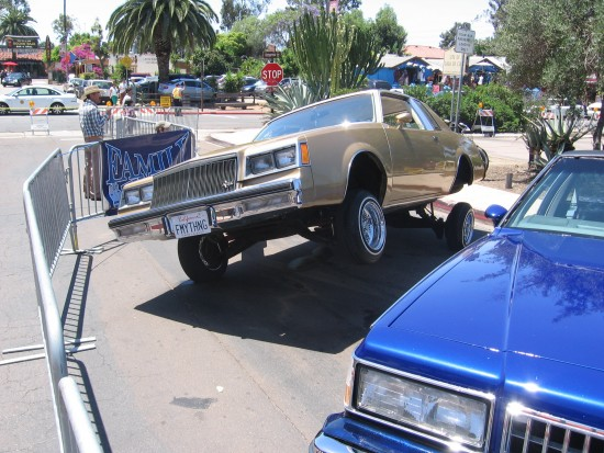Dramatic end of long line of hydraulic lowriders.