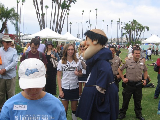 The Padres' friar mascot circulates in the crowd.