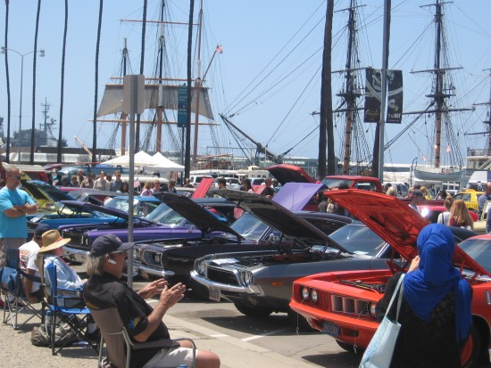 San Diego Maritime Museum behind classic cars.