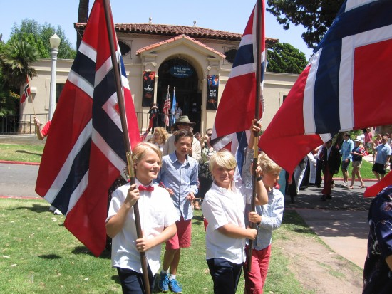 Parading flags open House of Norway lawn program.