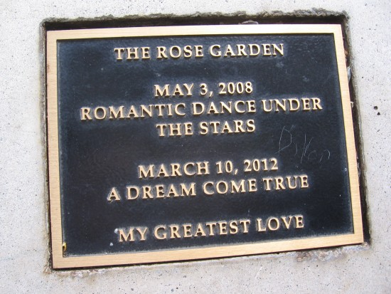 Plaque on one gazebo bench with romantic sentiment.