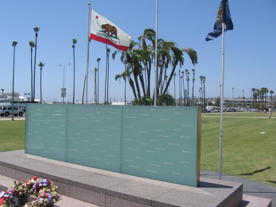 Glass wall memorial in park by County Administration Building.