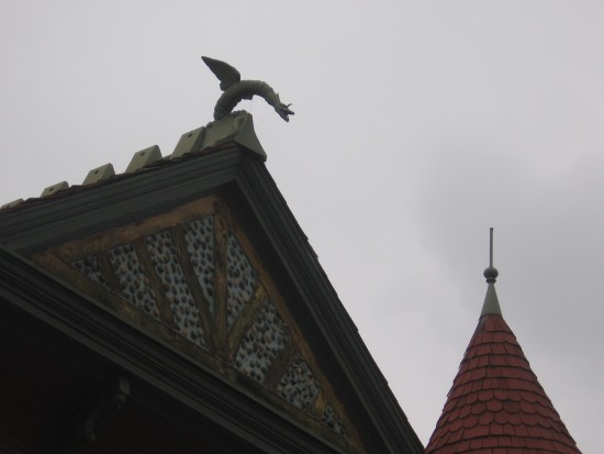 Another gargoyle perches on the roof!