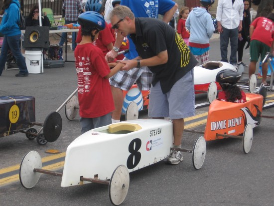Boy gets encouragement before racing in Soap Box Derby.