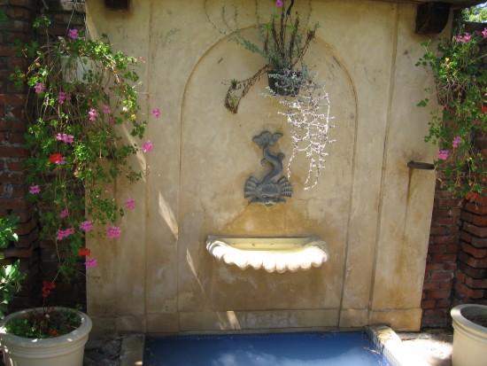 Small fountain at end of garden.