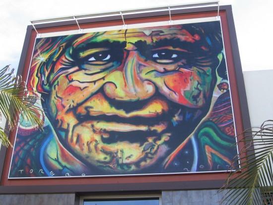 Face on bold mural at Mercado del Barrio.