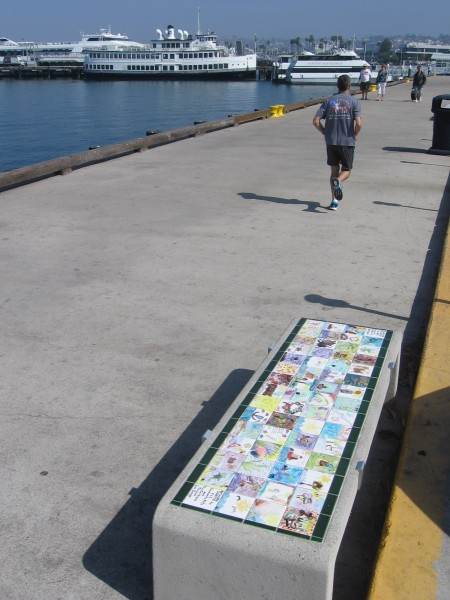 One of many benches featuring tiles painted by children.