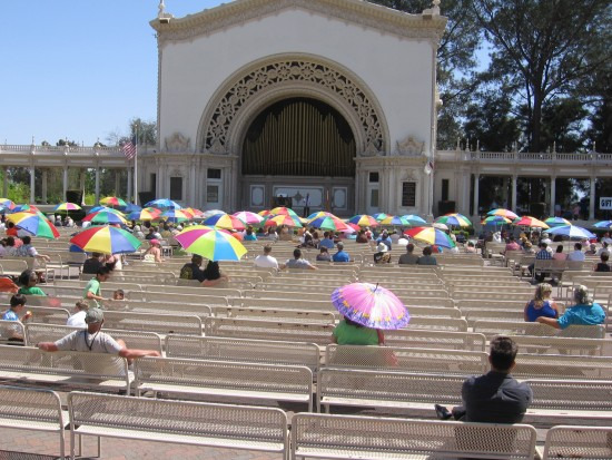 Organ lovers enjoy shade under the San Diego sun.