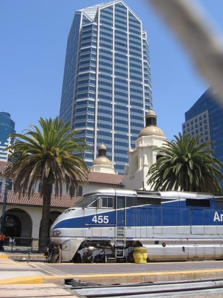 Amtrak train parked by historic Santa Fe Depot.