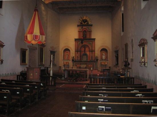 Beautiful radiant altar inside the quiet church sanctuary.