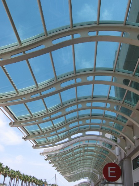 Looking up at glass awning above main entrance.