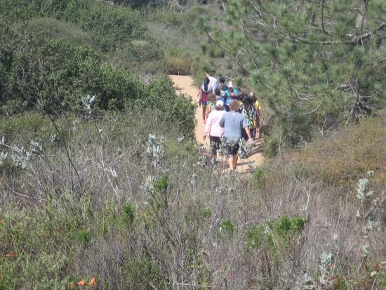Hikers take beautiful trail through coastal chaparral.