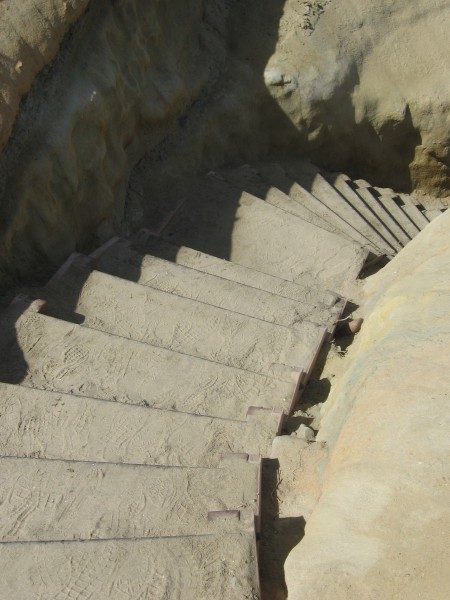 Steps head steeply down from cliffs.