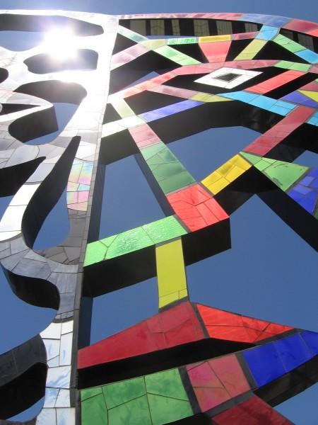 Closer look at light shining from mosaic sculpture.