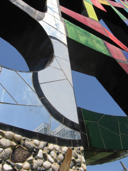 Ceramic and mirror artwork reflects nearby Hilton.