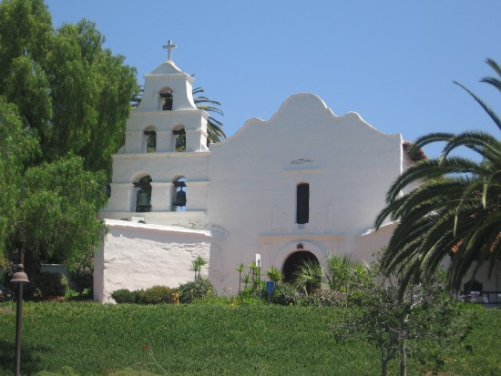Facade of old Mission San Diego seen from parking lot.