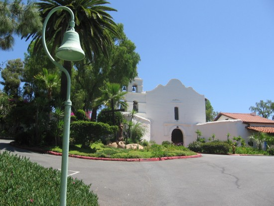 El Camino Real bell in front of California's first Spanish mission.