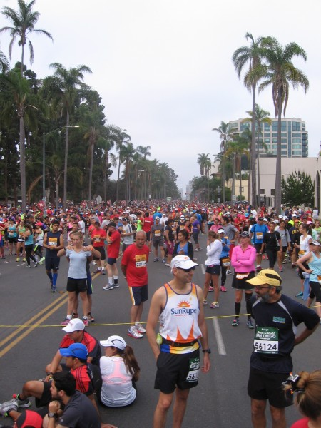 Half marathoners gather into the corrals for their race.
