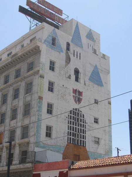 Faded castle on side of San Diego's old Hotel Churchill.