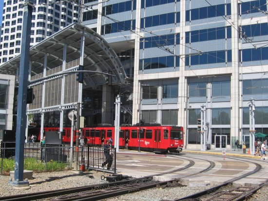 San Diego Trolley stops at cool America Plaza station.