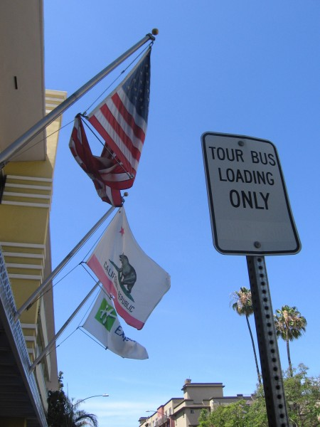 Tangled flag hangs in front of San Diego hotel.