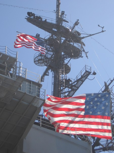Patriotic flags on USS Midway superstructure.