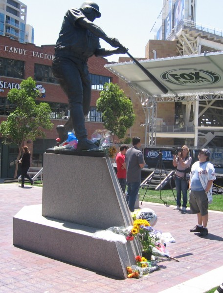 Flowers decorate the base of Tony Gwynn statue.