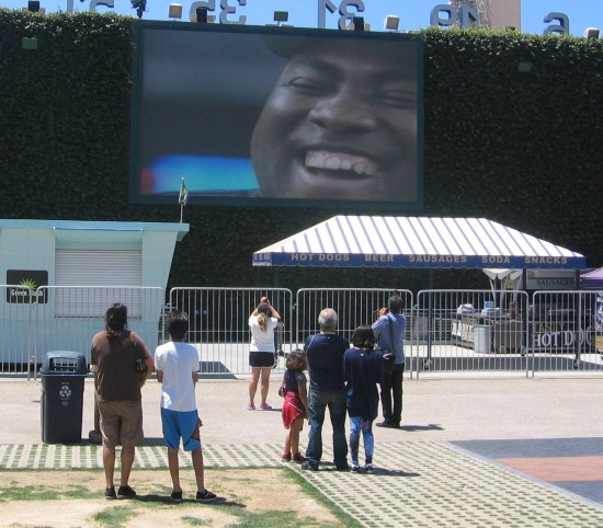 Padres fans watch the big smiling face of Tony Gwynn.