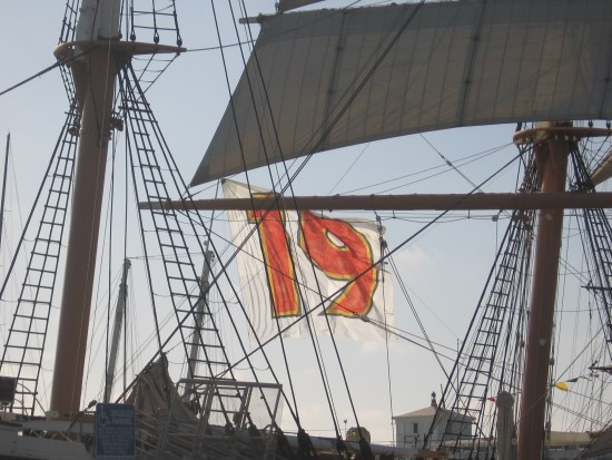 Tony Gwynn flag on San Diego Bay seen between Star of India masts.