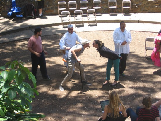 Actors rehearse A Nation of Pain in Balboa Park's small Zoro Garden.