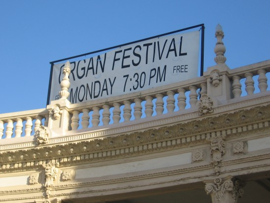 Big banner on Organ Pavilion's colonnade announces the event.