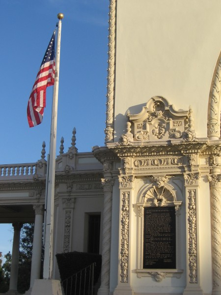 Flag and a bronze plaque of the historic pavilion.