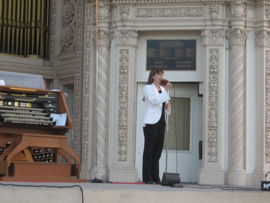 Dr. Carol Williams, civic organist, announces guest musician.