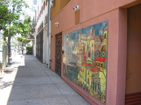 Looking down the sidewalk where the mural is located.