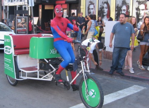 It's Spidey driving a pedicab and giving me a thumbs up!