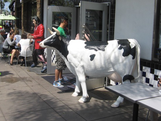 Large cow stands in front of Coronado ice cream shop.
