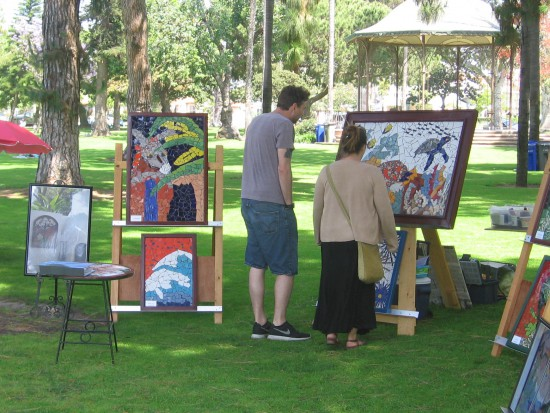 Checking out art for sale in Coronado's Spreckels Park.