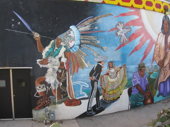 Diverse images from Latino culture in the large mural.