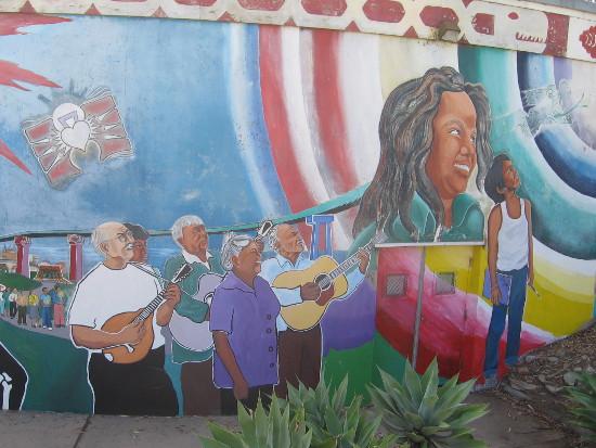 Hispanic music, education and optimism are portrayed.