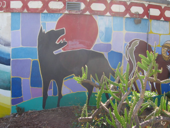 Colorful mural contains many animals from the Americas.