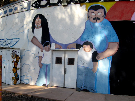 Latino family stands proudly in the San Diego mural.