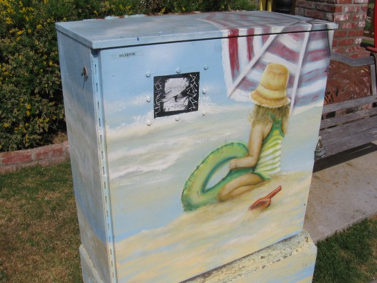 Utility box on Seacoast Drive shows girl playing in the sand.