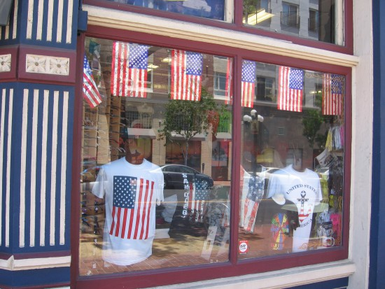 Shop window in the Gaslamp filled with American flags.