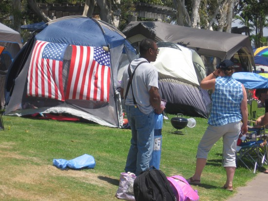 The bayfront parks are crowded with tents and celebrating Americans.