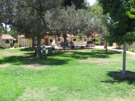The lawn of Balboa Park's International Cottages is empty.