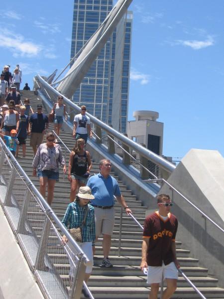Padres fans descend steps, anticipating baseball.