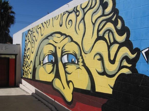 Street art between two buildings on Garnet Avenue.